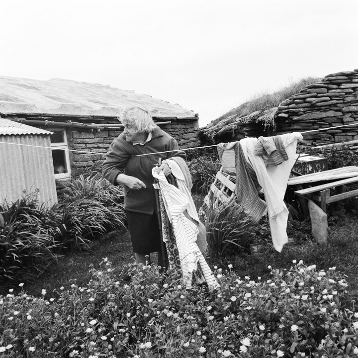 Jennie O' Scottigar, The oldest lady on the island when this was taken, bringing in her washing, 2008, North Ronaldsay.