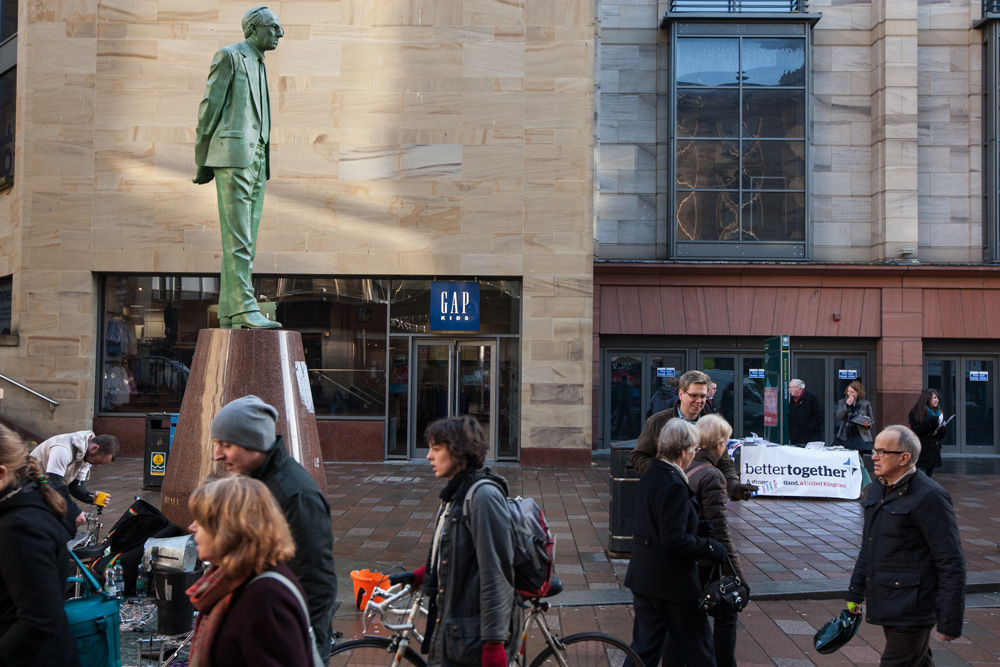 Better Together campaigner man a stall, near the statue of  Donald Dewar in Buchanan Street, Glasgow. ©Jeremy Sutton-Hibbert 2014, all rights reserved.
