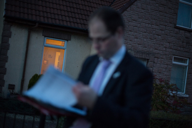 Better Together campaigner checks names on the voters role, while distributing leaflets in Rutherglen, Glasgow. ©Jeremy Sutton-Hibbert 2014, all rights reserved.