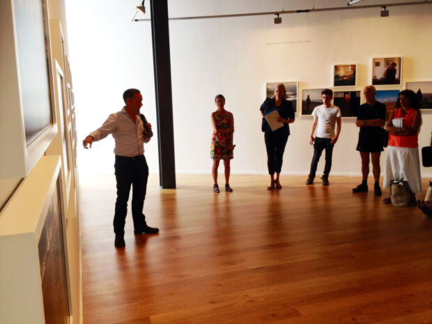 Jeremy Sutton-Hibbert talks to the audience at Impressions Gallery about his body of work 'Edge of an Empire', which is exhibited as part of 'Beyond The Border: New Contemporary Photography from Scotland' on show at Impressions Gallery Bradford 1st July - 27th September 2014. image © Colin McPherson July 2014
