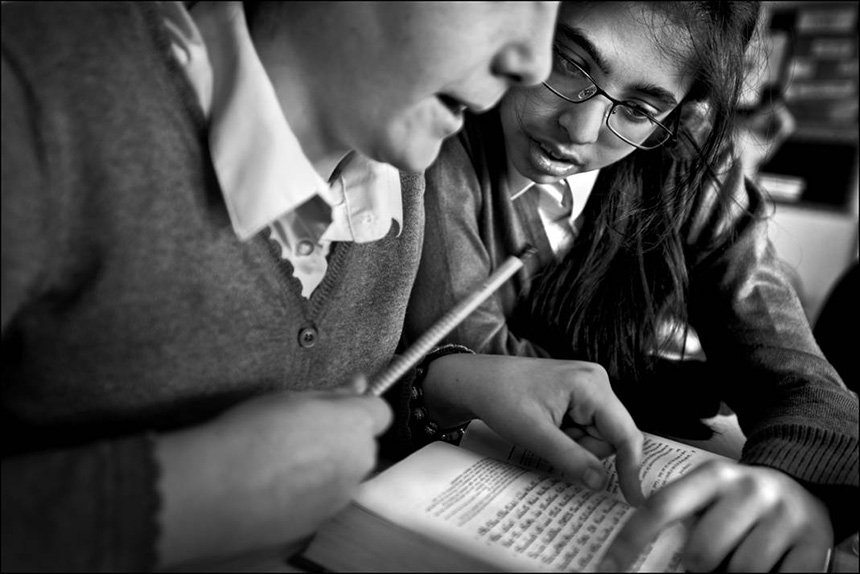Jewish and Muslim pupils studying the Torah together in a religious education class at Calderwood Lodge Primary School. Photograph © Judah Passow, 2013.