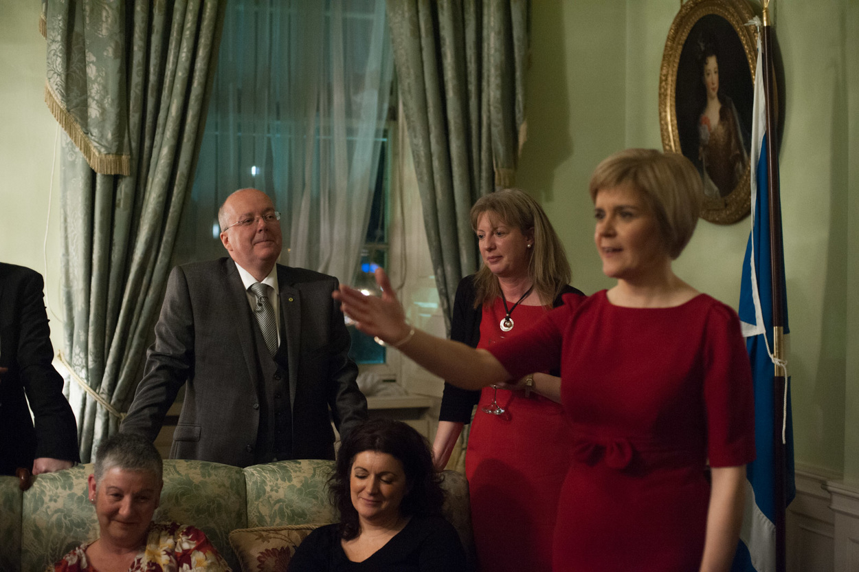 Nicola's husband Peter Murrell proudly looks on as Nicola thanks friends and family at a reception in Bute House. Photograph © Peter McNally, 2014 all rights reserved.