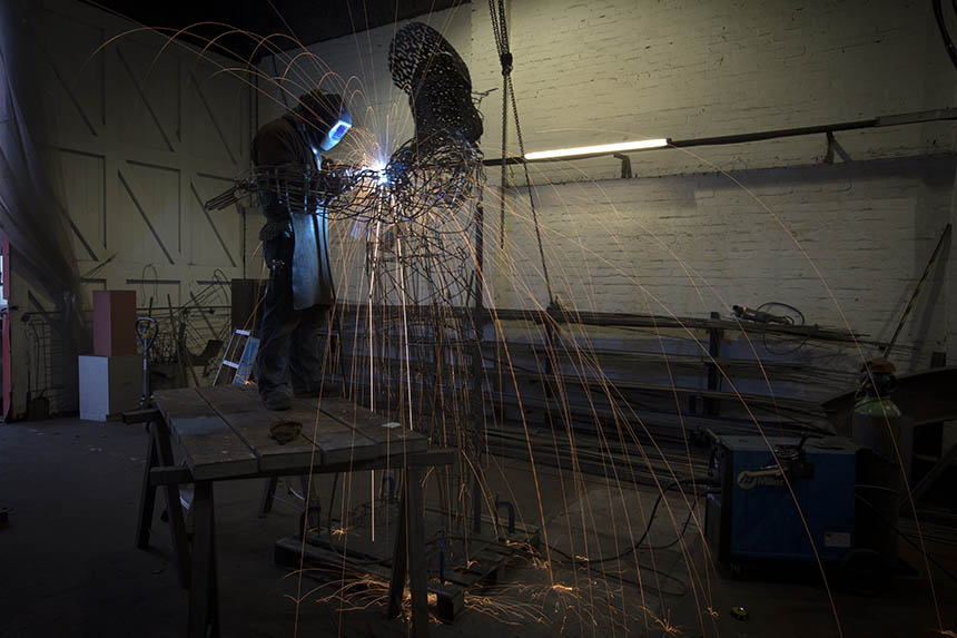 Andy Scott welding Steel Man in his studio workshop. Photograph © Colin McPherson 2015, all rights reserved.