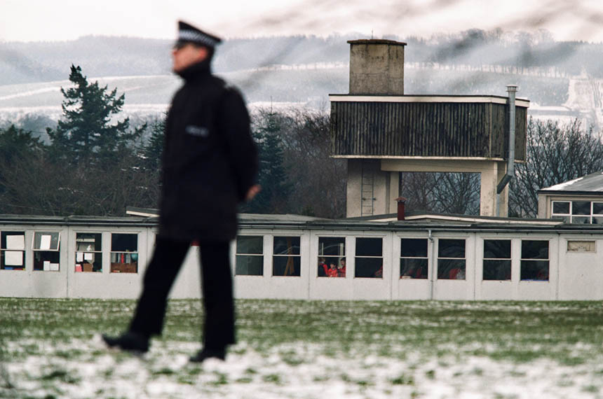 A police officer stands guard. Photograph © Colin McPherson 1996, all rights reserved.