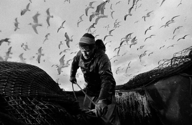 Bill Smith secures the nets, aboard the 'Argosy' seine-net fishing boat in the North Sea, Scotland, February 1995. Photograph by ©Jeremy Sutton-Hibbert 1995.