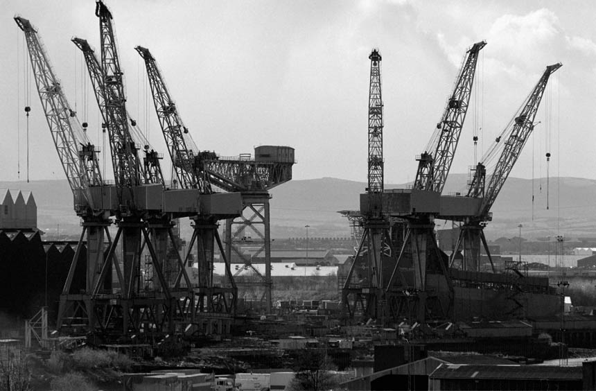 The cranes of the Govan shipyard on the banks of the Clyde in Glasgow. © Colin McPherson 1999, all rights reserved.