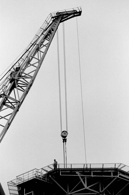A solitary worker and a crane at the Govan shipyard. © Colin McPherson 1999, all rights reserved.
