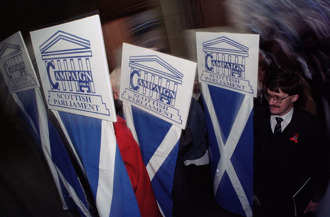 Campaigners with banners arriving at the General Assembly of the Church of Scotland building. © Colin McPherson 1995, all rights reserved.