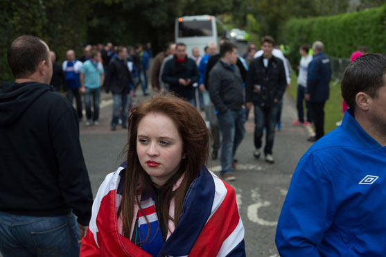 Rangers football fan. Photograph by Jeremy Sutton-Hibbert, 2012.