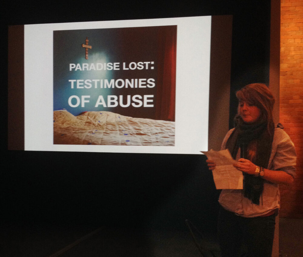 "Emily Macinnes talks to the audience and shows her work ""Paradise Lost: Testimonies of Abuse""  © Sophie Gerrard/Document Scotland 2014 all rights reserved"