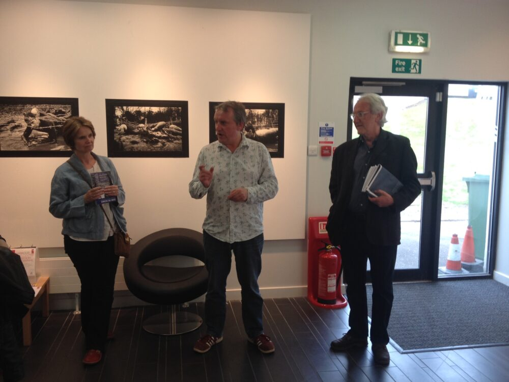 Malcolm Dickson (centre) of Street Level Photoworks introduces the show.