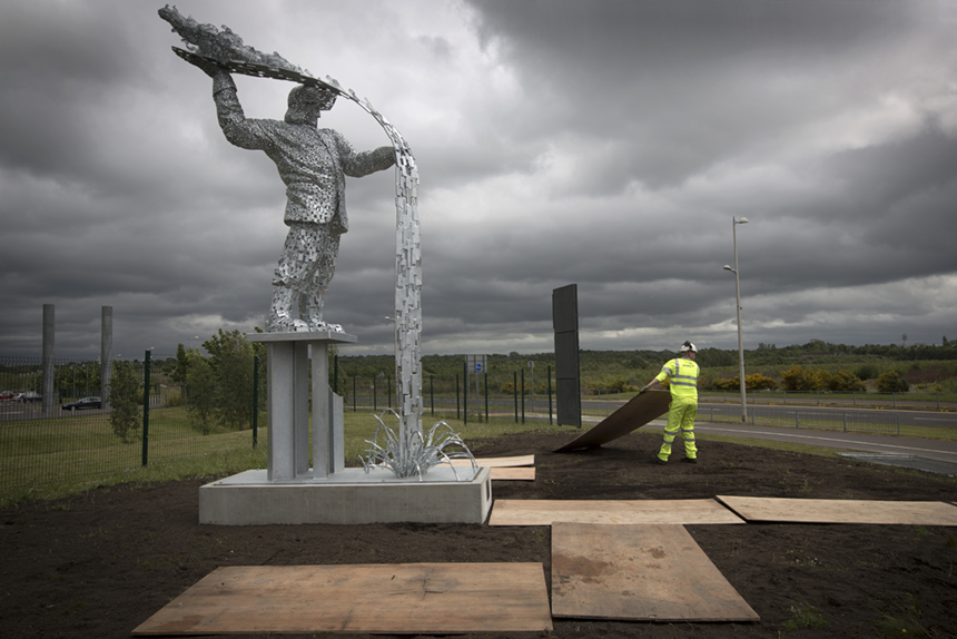 A workman preparing the site for the official unveiling of Steel Man, Ravenscraig. A detail on Andy Scott's 'Steel Man sculpture. Photograph © Colin McPherson, 2015 all rights reserved.