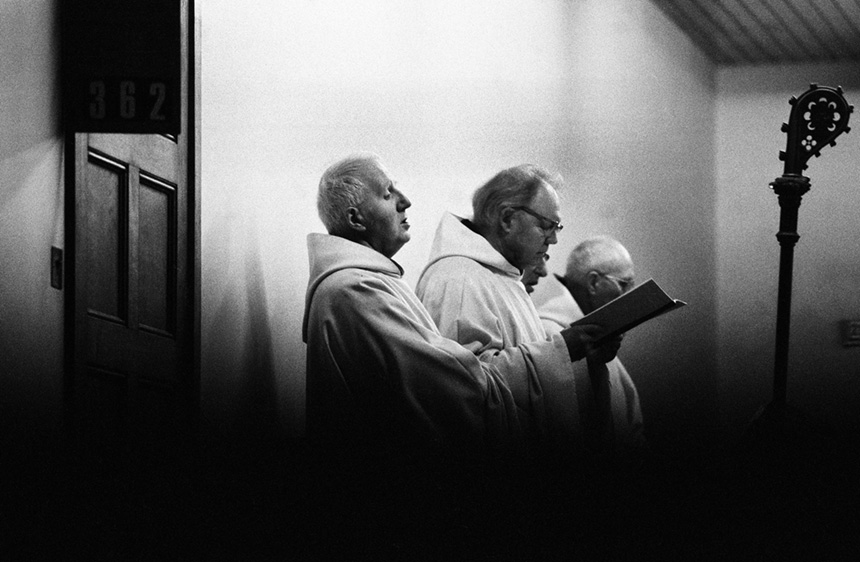 Monks at dawn prayers in the chapel at Sancta Maria Abbey at Nunraw. Photograph © Colin McPherson, 1996 all rights reserved.