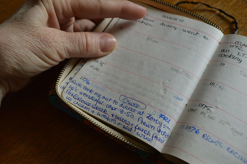 Mother holding open her diary March 19th 1976, describing her first date with my father. From 'Mother, Father' by Lucie Rachel. ©Lucie Rachel 2015, all rights reserved.