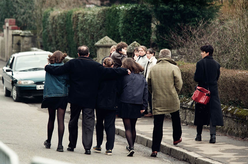 A group of adults and children embracing. Photograph © Colin McPherson 1996, all rights reserved.