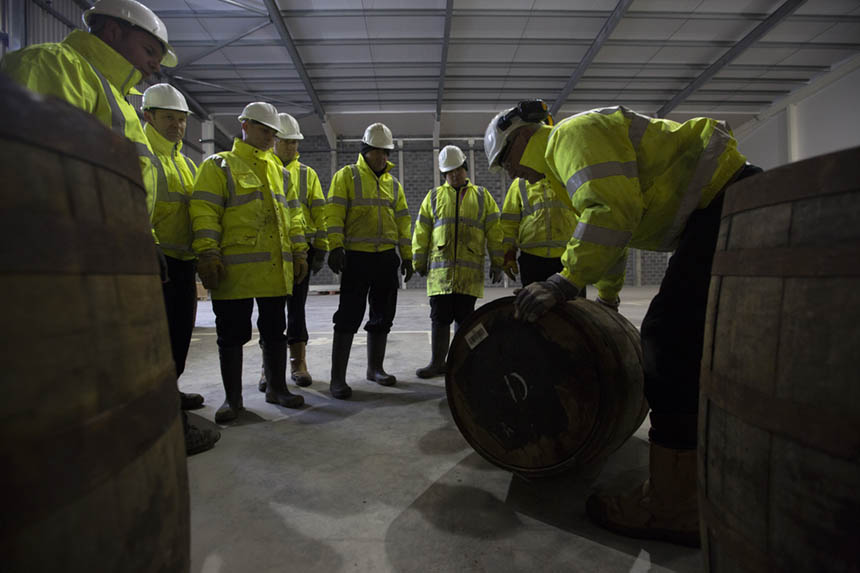 Examining newly-arrived barrels. Photograph © Colin McPherson, 2015 all rights reserved.