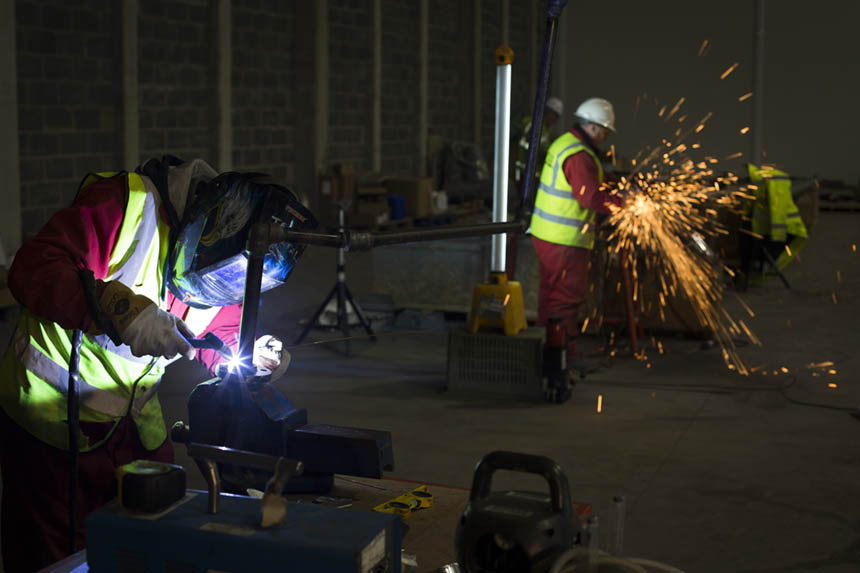Contractors welding parts for the stills. Photograph © Colin McPherson, 2015 all rights reserved.