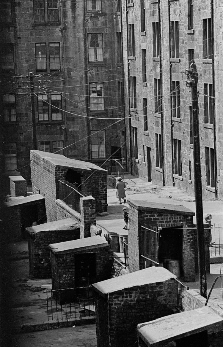 "View of Glasgow tenements © Nick Hedges/Shelter 1971  ""It is apparent in the number of times disaster hits the city, every year some tragic event reinforced its reputation upon the rest of the country. A tenement fire, a gas mains explosion, a football crowd disaster, the shipyard crisis, the unemployment rate, another fire disaster; the list is endless"". Nick Hedges"