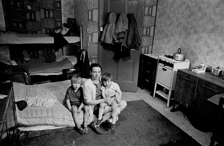 Mother living with her children in an overcrowded single end tenement flat Glasgow © Nick Hedges/Shelter 1971